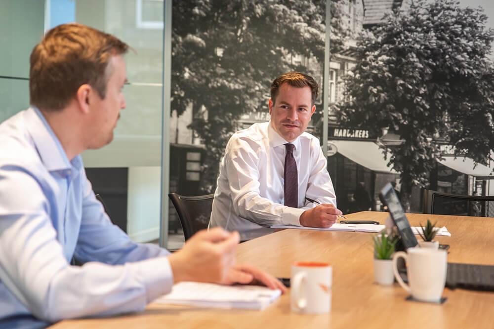 two men in boardroom