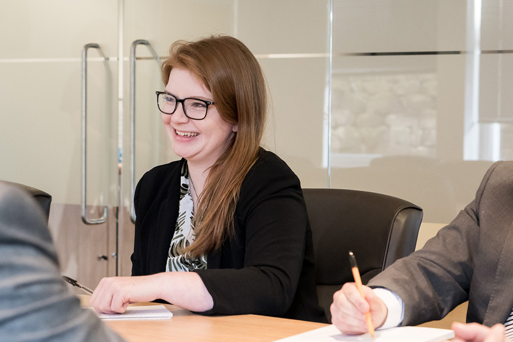 woman at boardroom table